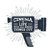 Hand drawn 90s themed badge with camcorder vector illustration and 'Cinema is life with all boring things cut out' ironic lettering.