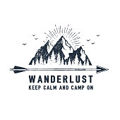Hand drawn travel badge with mountains textured vector illustration and ' Wanderlust. Keep calm and camp on' inspirational lettering.