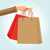 Hand holding two paper bags shopping. Vector illustration.