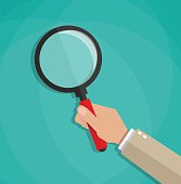 cartoon hand holding a magnifying glass. vector illustration in falt design on green background