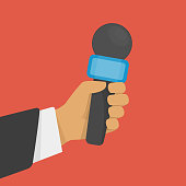 Hand holding microphone. Journalism, live news or reporters interviews concept. Mic in hands of man. Vector illustration in flat style. EPS 10.