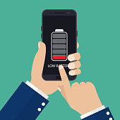 Hand holding smartphone with low battery on the screen. Vector illustration in flat style