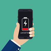 Hand holding smartphone with low battery on the screen.Vector illustration in flat style