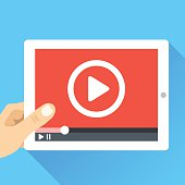 Hand holding tablet with video frame and play button. Video marketing, online cinema. Modern flat illustration, flat design elements for web banners, web sites, infographics. Vector illustration