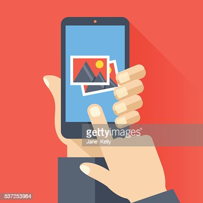 Hand holds smartphone with photos icon. Photo app. Vector illustration : Vector Art