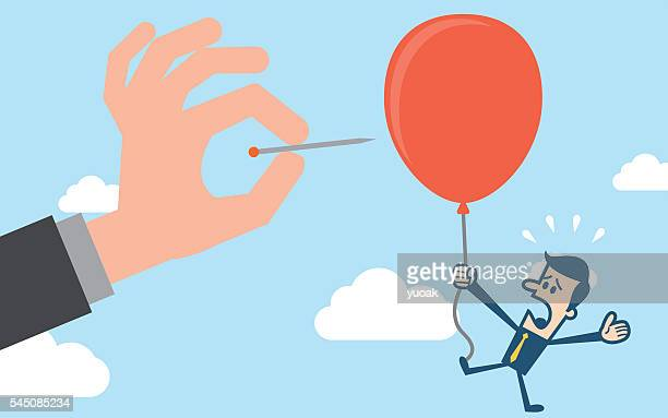 Hand pushing needle to pop the balloon of rival