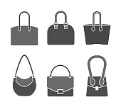 Handbag icons set in a modern flat style. Vector illustration in grey colors isolated on a white background. Fashion and accessories creative concept.