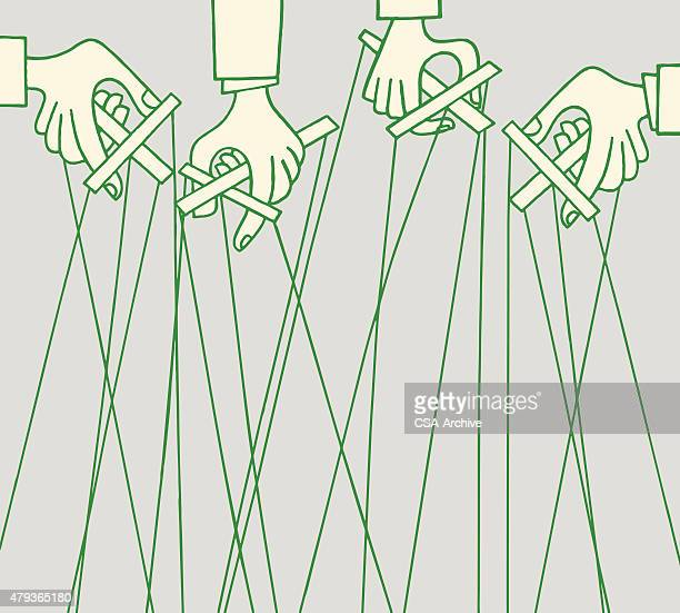 Hands Holding Marionettes