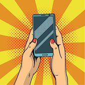 Hands holding smartphone pop art. Female hands hold a mobile phone. Vector illustration in comic style.