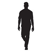 Handsome man in t-shirt walking forward, isolated vector silhouette, front view