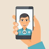 Handsome young man boy takes selfie using a smartphone. Vector illustration.