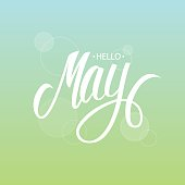 Handwritten phrase Hello May. Hand drawn lettering with blurred background. Calligraphic element for your design. Vector illustration.
