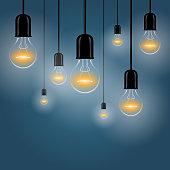Hanging light bulbs with a luminous on a dark background. Vector illustration for your design.