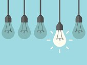Row of five hanging lightbulbs with one burning on blue background. Inspiration, discovery, idea and insight concept. Flat design. Vector illustration. EPS 8, no transparency