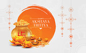 Creative Happy Akshaya Tritiya Festival Background Design with Decorative Elements Kalasha, Lamps, Lotus Floral Ornet