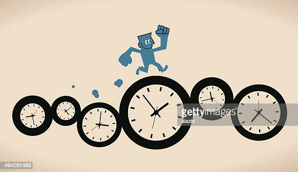 Happy confident smiling businessman running on group of time clocks