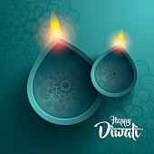 happy diwali. traditional indian diya oil lamp.