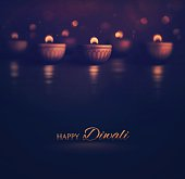 Happy Diwali, burning diya. Illustration contains transparency and blending effects, eps 10