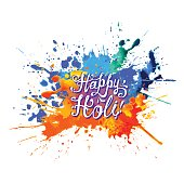 Happy Holi! Hand written inscription on rainbow splash paint.