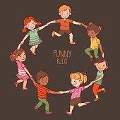 Happy kids dancing in a circle. Cute boys and girls having fun