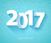 Happy New Year 2017 background. Calendar design typography vector illustration. Paper white digits design with shadows and snowflakes on colorful background.