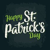 Happy Saint Patrick's Day calligraphy lettering. Vector vintage color engraved illustration on dark background