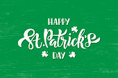 Happy Saint Patrick's day celebration text with shamrock. Hand drawn brush lettering for greeting card, banner, invitation, postcard, flyer, poster. Vector illustration on green texture background