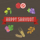 Happy shavuot headline on ribbon with 7 species and wooden background, flat design