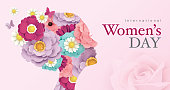 International Women's Day poster design with women's side face silhouette and blossom flowers