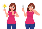 Happy young woman holding bright bulb and pointing index finger. Unhappy woman/girl  holding dull bulb and pointing to it. Idea, invention, innovation concept illustration in vector cartoon style.