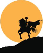 The headless horseman rides against the full moon. See similar files: