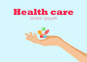 Health care horizontal banner with womans hand holding colorful medicines pills capsules for info graphics website print media vector illustration. Isolated on light blue background. Place for text