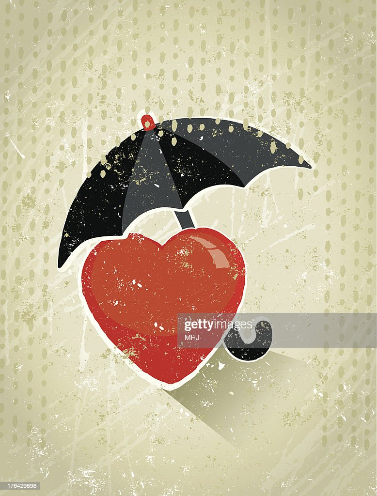 health insurance giant umbrella protecting a heart symbol from