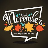 hello November, bright fall leaves and lettering composition flyer or banner on dark background