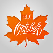 Hello October lettering with maple leaf on light background. Paper cut style. Modern brush calligraphy. Autumn banner. Vector typography for social media banner, greeting card, poster, flyer. EPS10