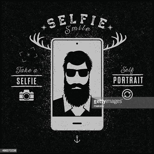 Hipster image of a bearded man taking a selfie