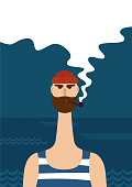 An image of hipster sailor with thick beard and pipe