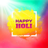 Happy Holi festival vector banner design with text and paint splashes in frame. Abstract background for Indian spring holiday