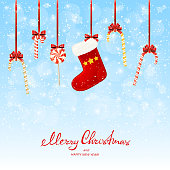Lettering Merry Christmas and Happy New Year with holiday decorations. Red Christmas sock and candy canes on a white wooden background, illustration.