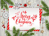Festive Christmas card with fir tree and festive decorations balls, stars, snowflakes on wood background. Christmas template for banner, ticket, leaflet, card, invitation, poster and so on