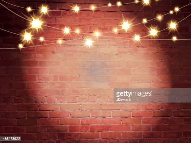 Horizontal old fashioned brick wall with elegant string lights background