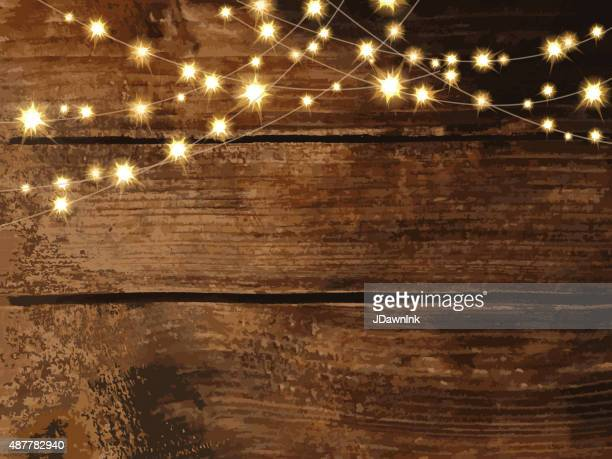 Horizontal wooden background with string lights and jars