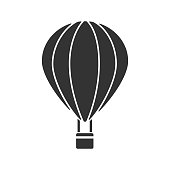 Hot air balloon glyph icon. Vector silhouette