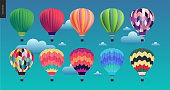 Hot air balloons - set of various colored balloons in the sky with clouds