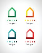 Abstract and colorful house design in modern style, green, orange, blue und red color set. Real estate concept.