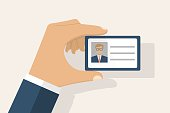 Male businessman holds identification card in hand. With permit. ID Card icon. Vector illustration, flat design style. Personal identification. Access control. Sign id card. Personal document in hand.