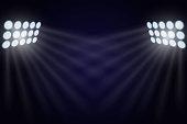 illuminated by searchlights. Stock vector illustration.