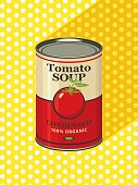 Vector illustration of tin cans with the label of condensed tomato soup on a background of yellow tablecloth with white polka dots