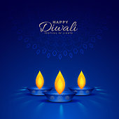 illustration of burning diya on blue background for happy diwali celebration
