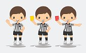 soccer referee with card